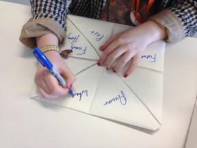 preparing paper fortune tellers